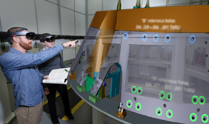 Photo augmented reality view of technician working on machinery