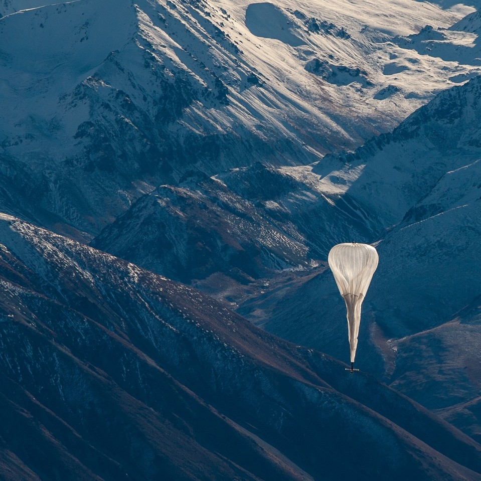 Photo of Loon Ballon flying above mountains