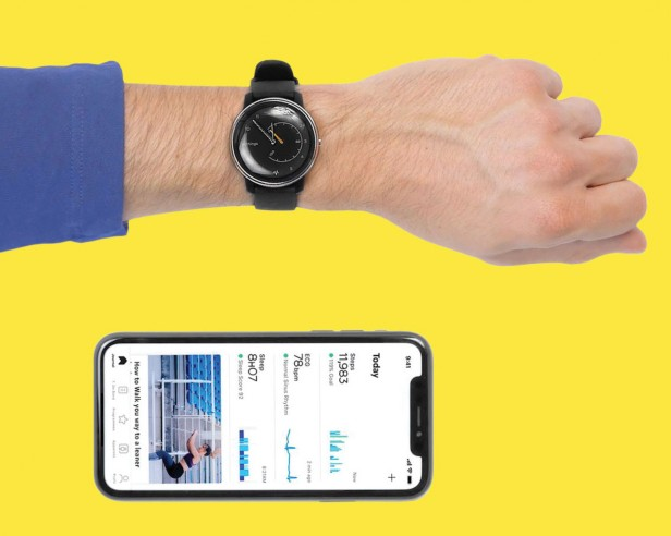Photo of wrist with watch next to iPhone open to app screen