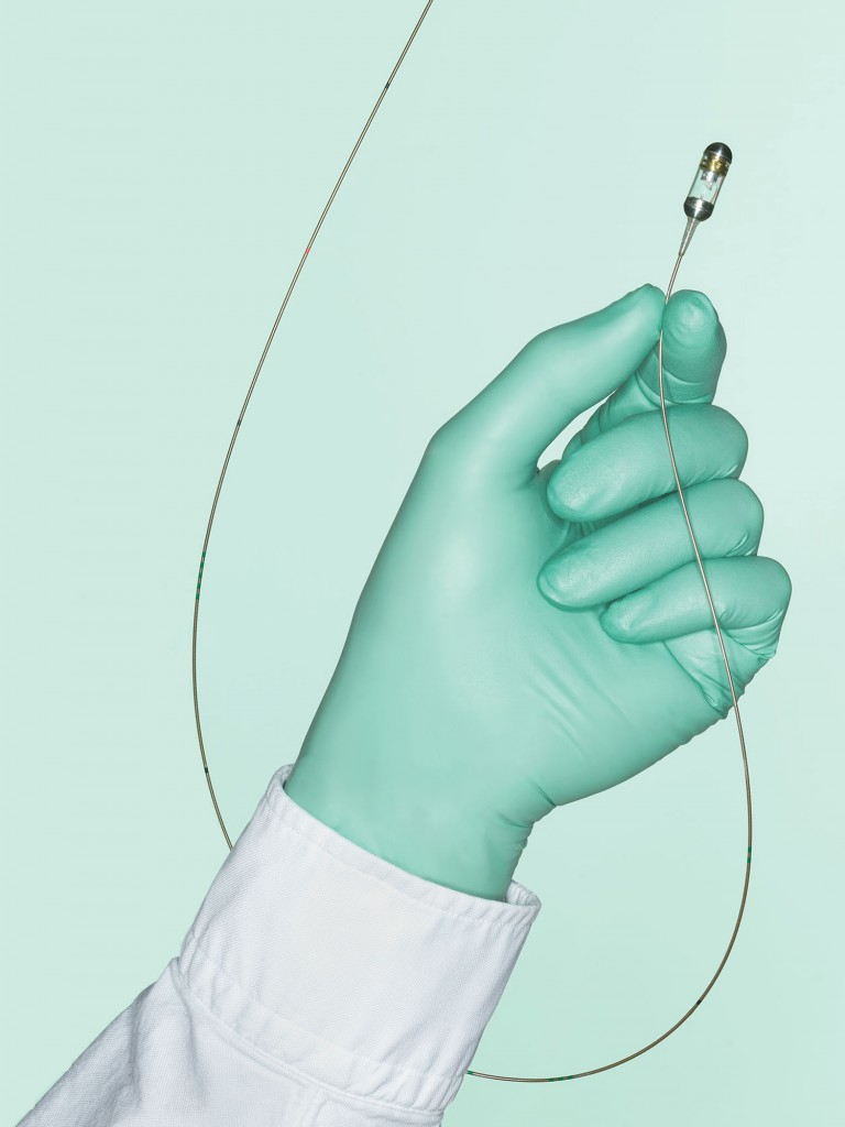 image of a gloved hand holding a gut biopsy device