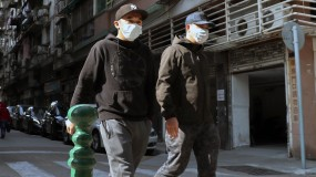 People walk on the street in Macau wearing face masks to protect themselves from coronavirus.