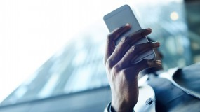A man holds a smartphone