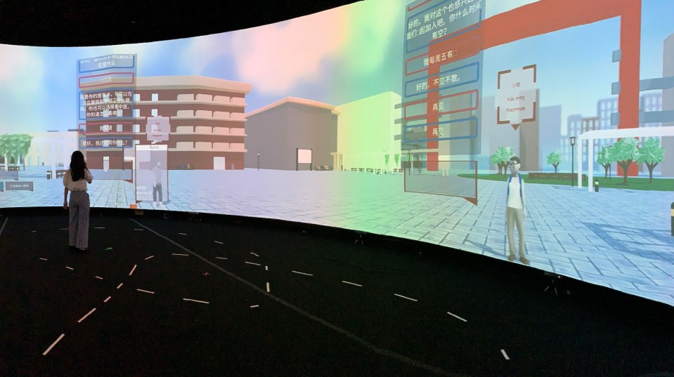 An image of students standing in the immersive virtual environment