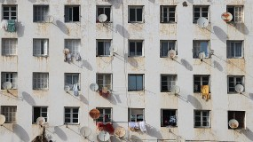 An image of windows with satellite dishes