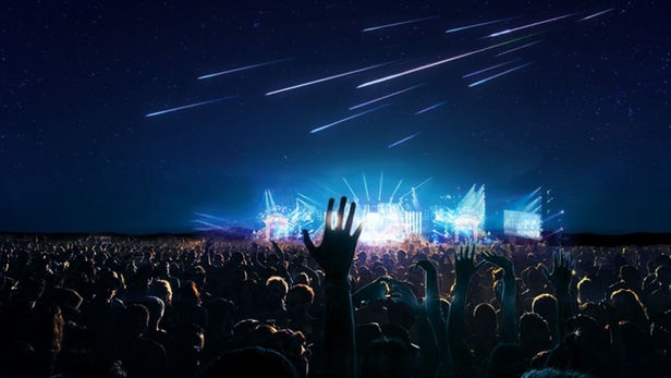 A meteor shower above a crowd at a live music concert