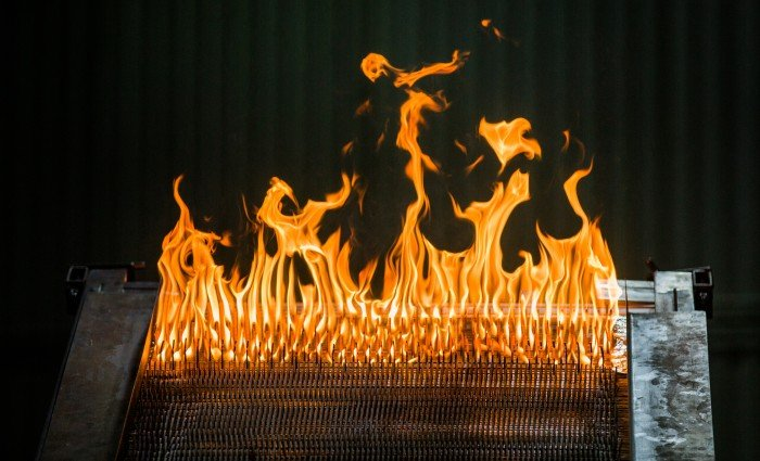 "An image of ""Little Bertha,"" which is packed with high cellulose cardboard and MDF. As the cardboard and MDF burns, it demonstrates the spread of fire up a slope, and to also shows a very specific ""U formation"" the flames take on."