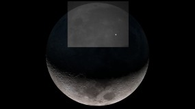 Image of the moon with a flash on the surface