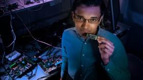 Nabil Imam with Intel's Loihi chip.