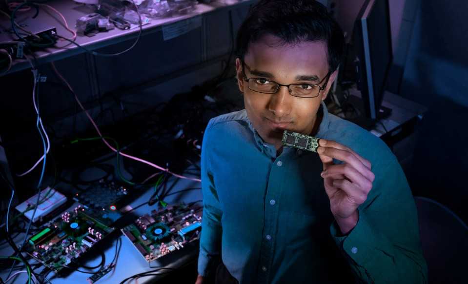 Nabil Imam with Intel's Loihi chip.
