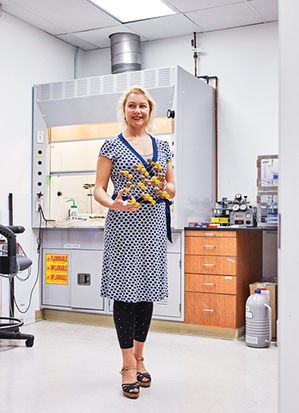 Greer in her Caltech lab, holding a model of the atomic structure of a metal.