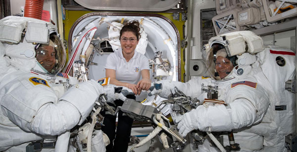 NASA astronaut Christina Koch (center) with fellow astronauts Nick Hague (left) and Anne McClain (right).