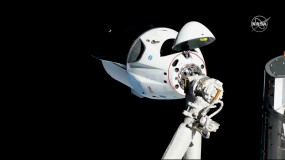 The SpaceX Dragon capsule docking at the International Space Station