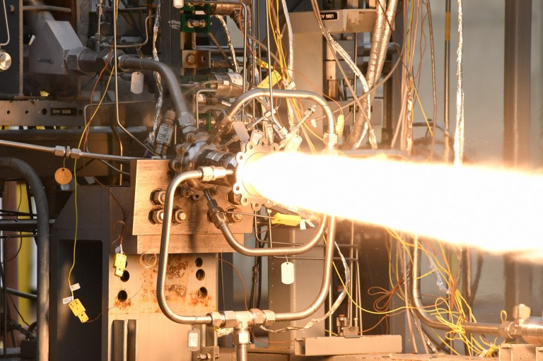 Image of engineers test-firing a 3D-printed rocket engine combustion chamber at NASA's Marshall Space Flight Center in Huntsville, Alabama.