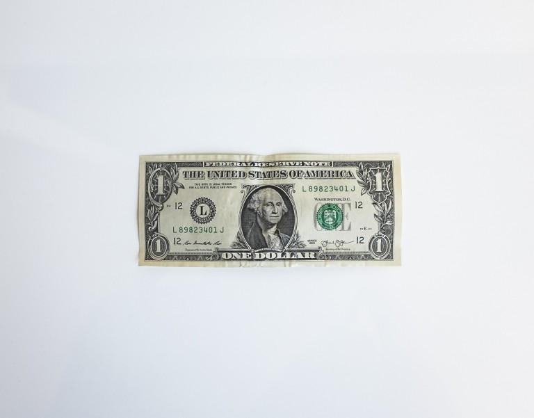 Dollar bill on a white background