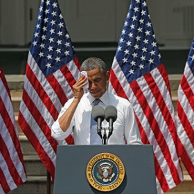 POTUS wiping brow with handkerchief