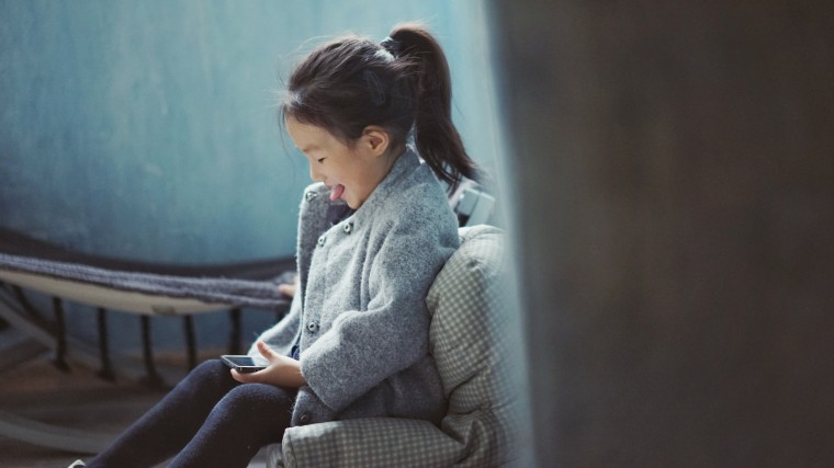 A child using a smartphone