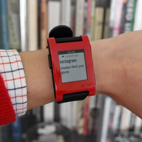 Pebble watch displaying Instagram update