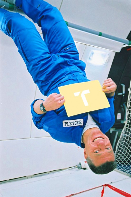 Man in aircraft floating upside down