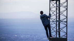 image of person hanging off cell phone tower 5g cancer fda report fcc