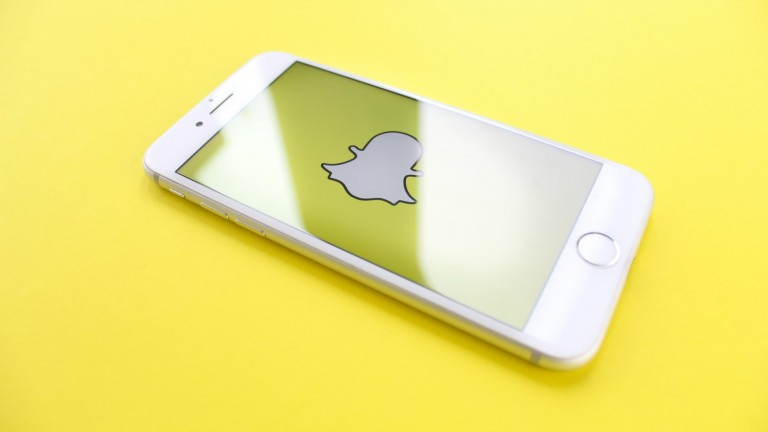 snapchat ghost icon on phone with yellow background snap here for you mental health depression anxiety suicide teen facebook instagram twitter pinterest