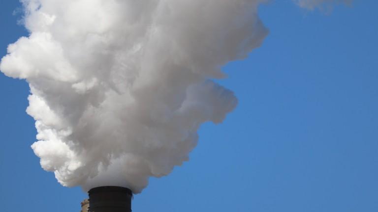A smokestack emitting gas