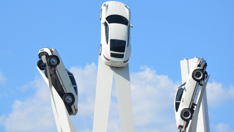 Image of three Porsche cars in the air.