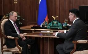 Russian President Vladimir Putin with the head of the country's telecoms regulator, Alexander Zharov