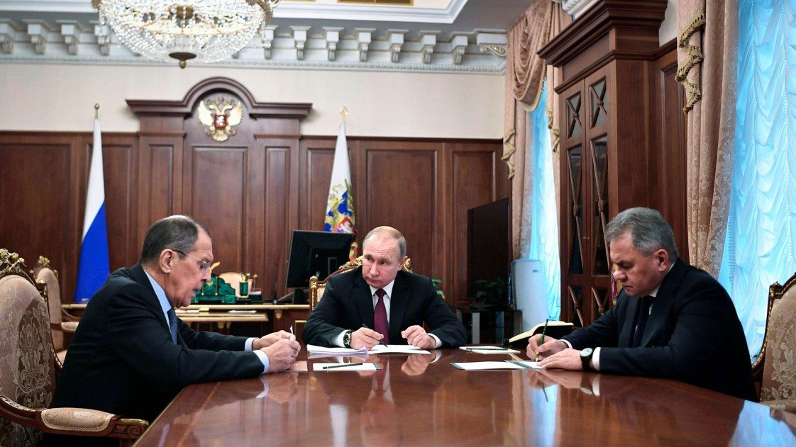 Putin meeting with Foreign Minister Sergei Lavrov and Defense Minister Sergei Shoigu.