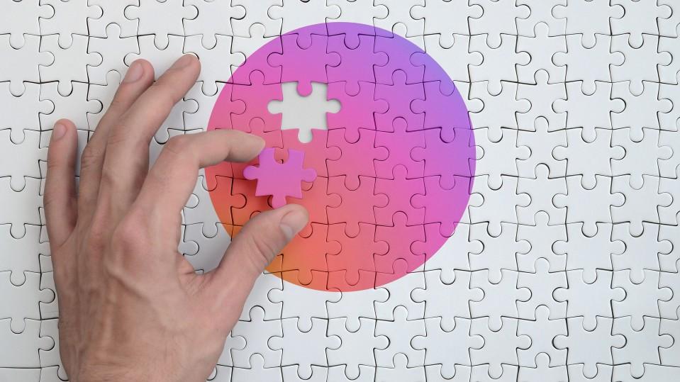 image of hand placing gradient puzzle piece instagram colors