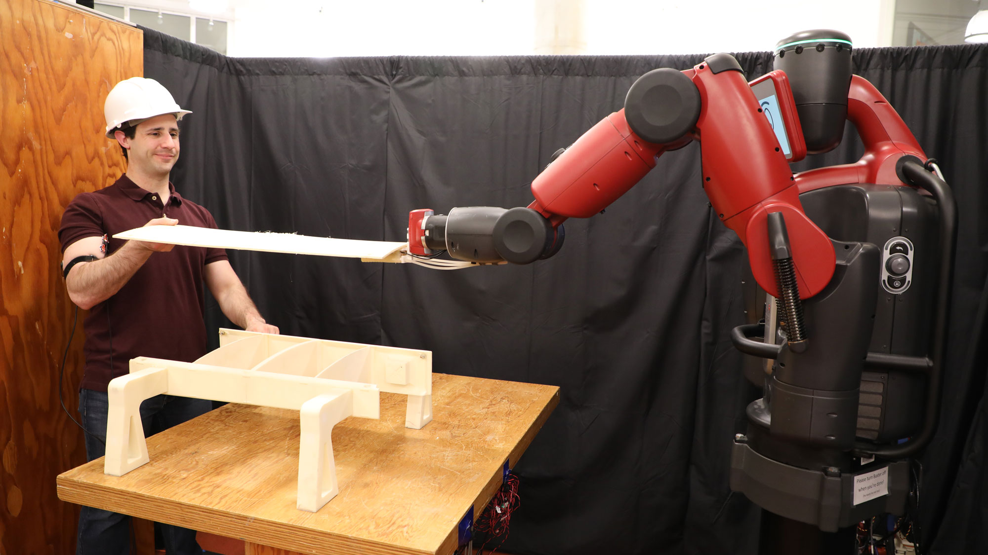This robot watches you flex to learn to be a better teammate
