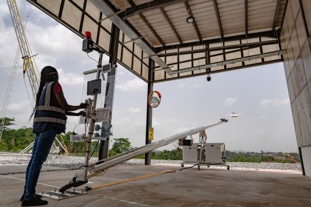 An image of a Zipline technician sending a drone