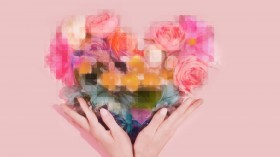 hands holding pixelated flowers roses in a heart shape against millennial pink background coronavirus dating okcupid tinder coffee meets bagel bumble virtual sex tech porn