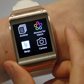 samsung watch on wrist showing four icons