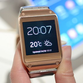 Samsung smart watch displaying time and temperature