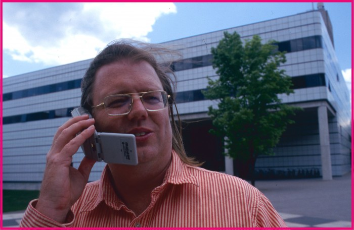 Photo of Christopher Schmandt on cell phone