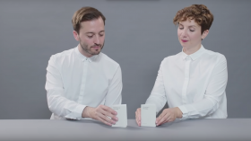 google special projects experiments digital wellbeing two people a man and a woman in white shirts with paper phone on table