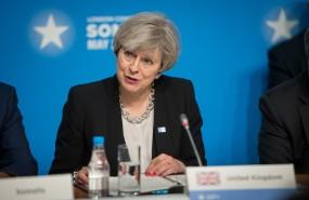 Theresa May at a desk talking