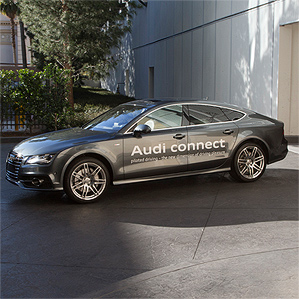 "Audi automobile with ""Audi connect"" signage painted on driver's side doors"