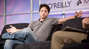 Photo of Sergey Brin sitting on a couch, arms open