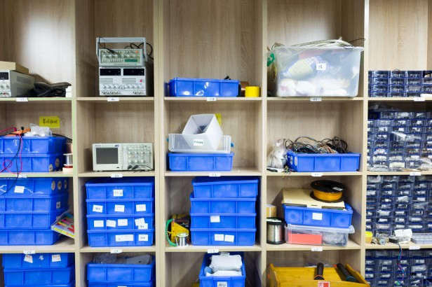 Photograph of makerspace storage containers with different parts.