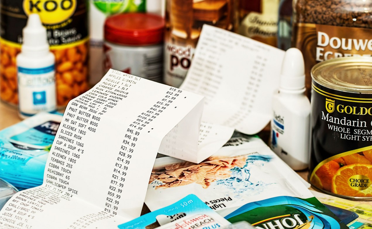 An image of a grocery receipt and grocery items