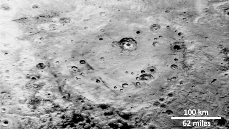 Cratered surfaces on both Pluto and Charon. The paper focuses on Charon's Vulcan Planitia, as it is an ancient surface with many clear craters.