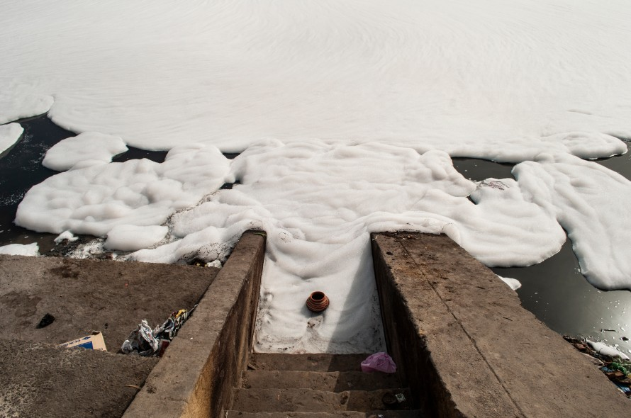 A photograph of the polluted Yamuna river