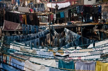 Image of a small outdoor area filled with clotheslines for air drying clothing and fabric after washing