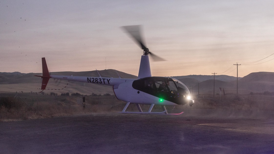 Image of SkyRyse autonomous helicopter taking off at dusk.