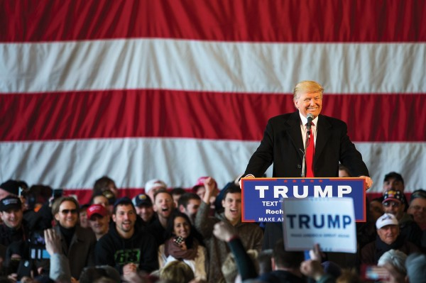 Photo of Donald Trump speaking at a podium to a crowd of people