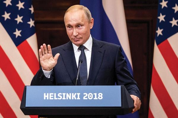 Photo of Vladmir Putin speaking at a podium