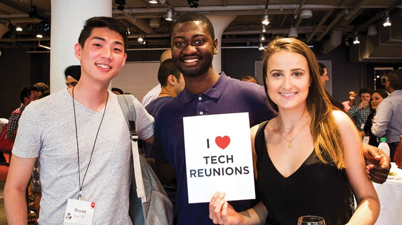 "Photo of three people, one holding a sign reading ""I Love Tech Reunions"""