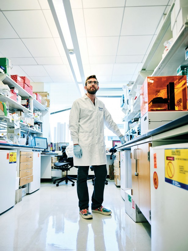 Photo of Colin Buss in a science lab