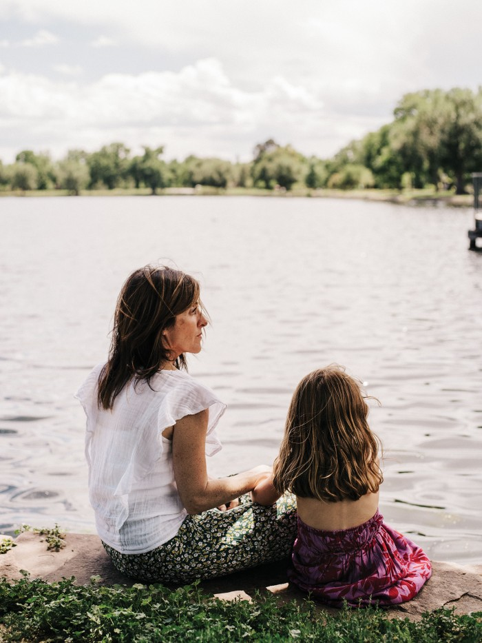 Photograph of Michele Krumper and her daughter sitting out by a lake